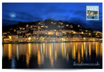 Looe Harbour at night postcard
