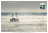 Fishing boat in mist postcard